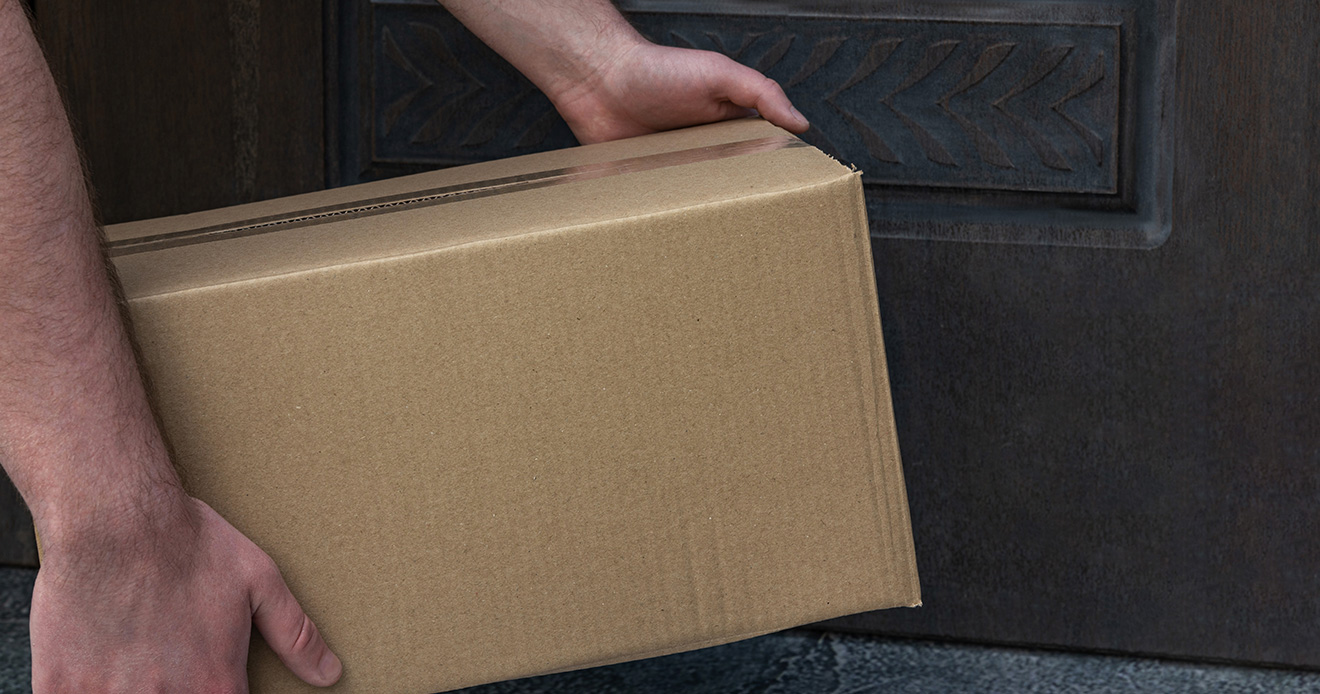 Man dropping off package at house