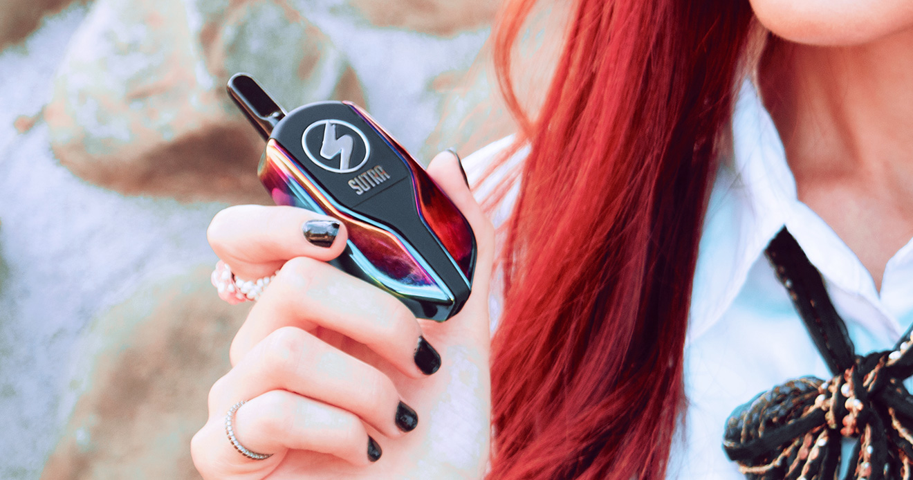 Sutra Squeeze Vaporizer in woman's hand