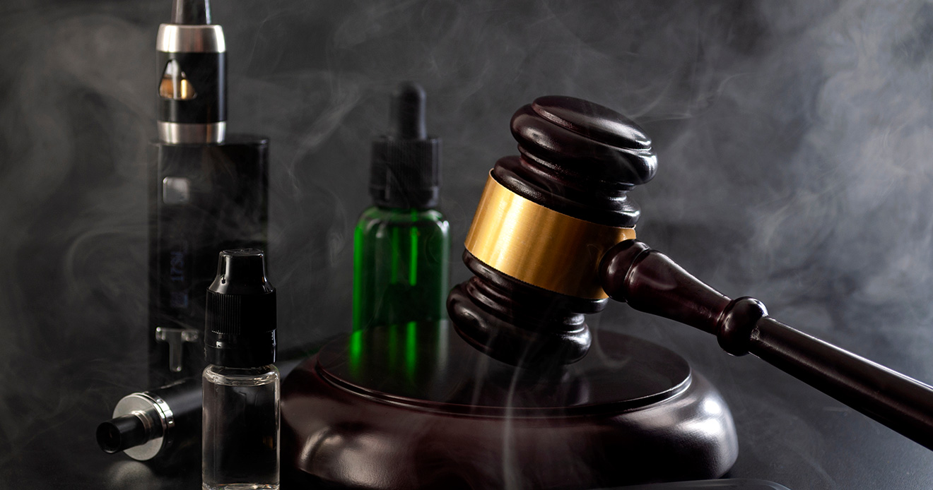 gavel with vaping products