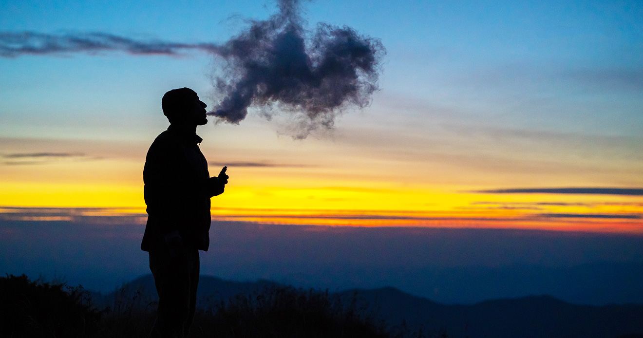 Man vaping in the mountains