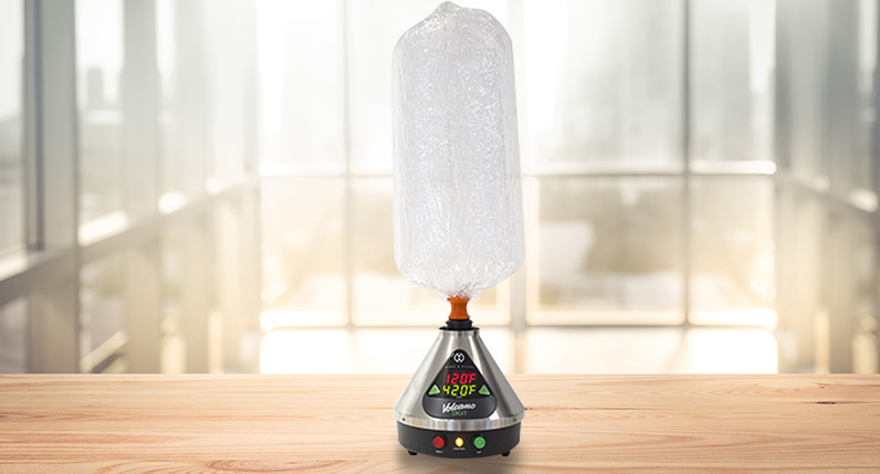 Digital Volcano Vaporizer in use standing on table